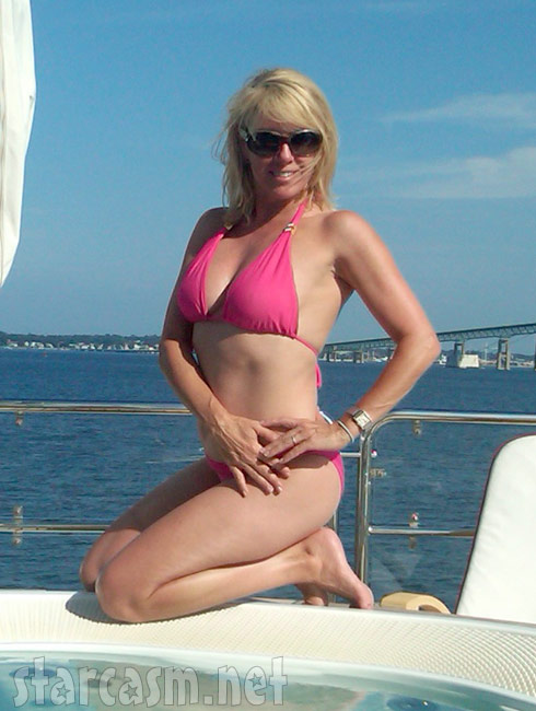 Housewife Ramona Singer poolside in a sexy hot pink bikini