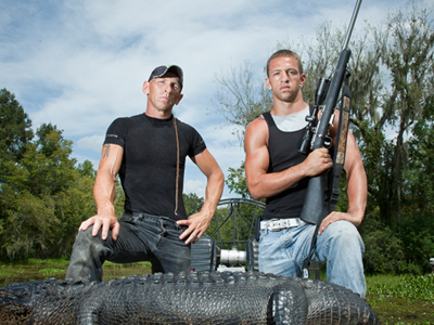 RJ and Jay Paul Molinere, with alligator and gun