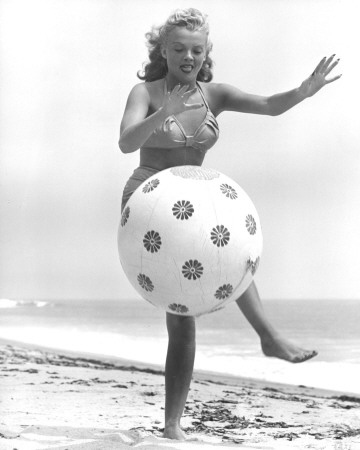 Yvette Vickers kicks beach ball