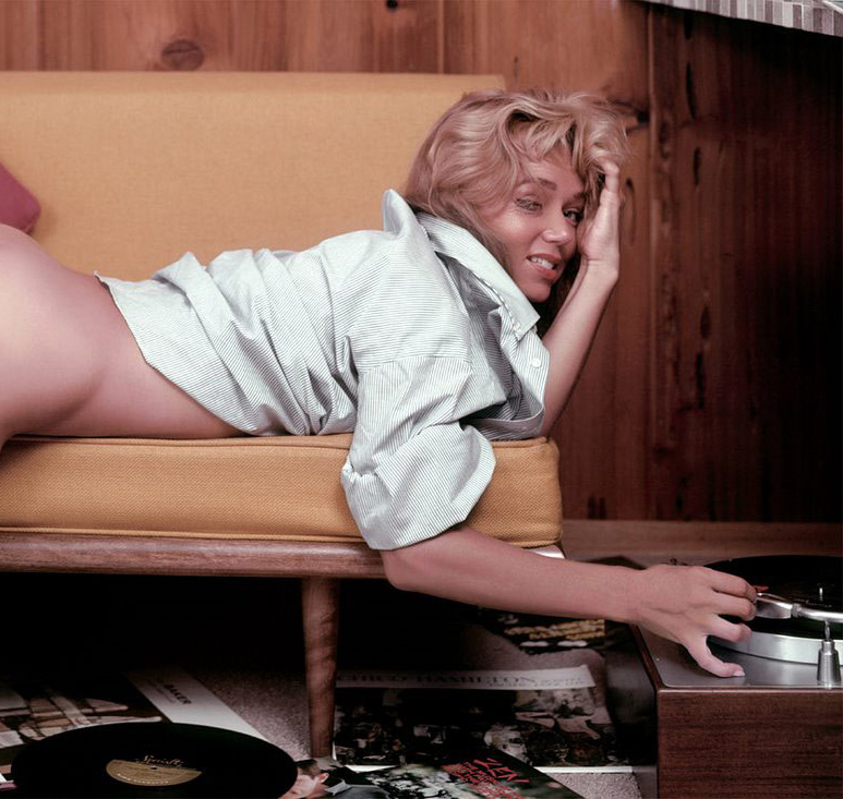 Yvette Vickers spins records in the July 1959 Playboy centerfold photographed by Russ Meyer