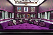 Purple conversation bed in the parlor of the Big Brother 13 house