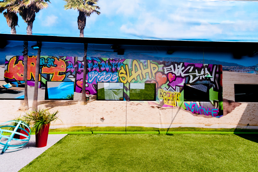 Big Brother Season 13 picture of the graffiti-themed backyard