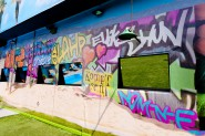 Photo of the backyard of the Big Brother Season 13 house with lots of graffiti