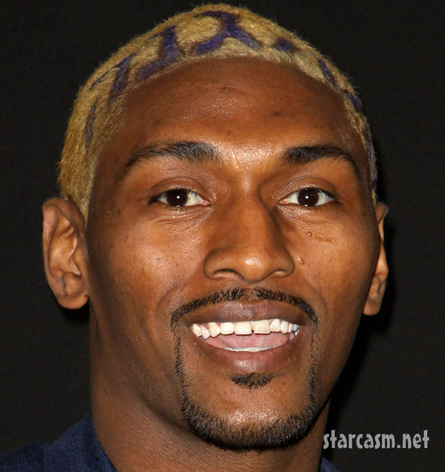 Metta world peace smiles as he gets a lakers themed haistyle metta