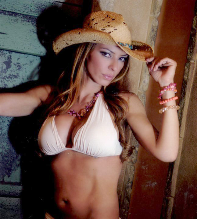 Drita D'Avanzo poses in a bikini and a straw hat for a calendar shoot