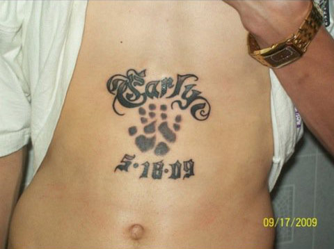 Tyler Baltierra's chest tattoo with his daughter Carly's name hand print and birthday
