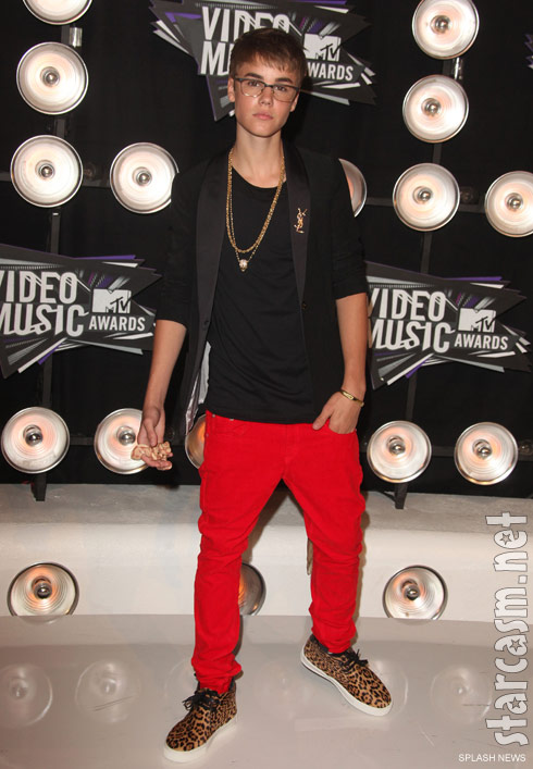 Full-length photo of Justin Bieber and his snake at the 2011 MTV Video Music Awards