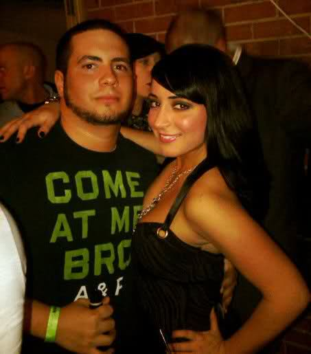 Angelina Pivarnick with a man wearing an Abercrombie & Fitch Jersey Shore themed shirt