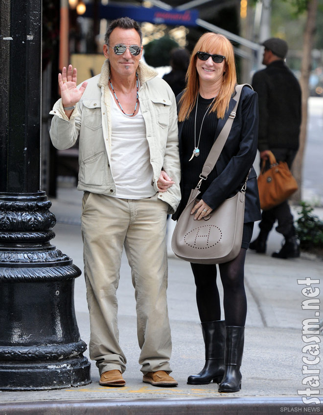 Bruce Springsteen waves to photographers while with wife Patti Scialfa in NYC