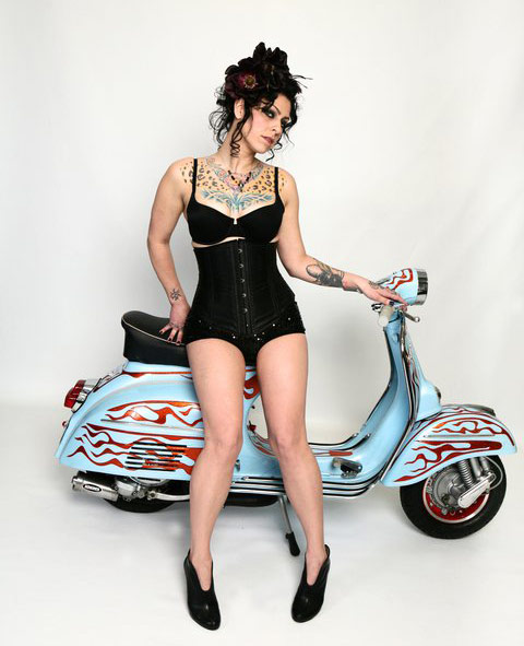 American Pickers' sexy Danielle Colby Cushman with a retro scooter