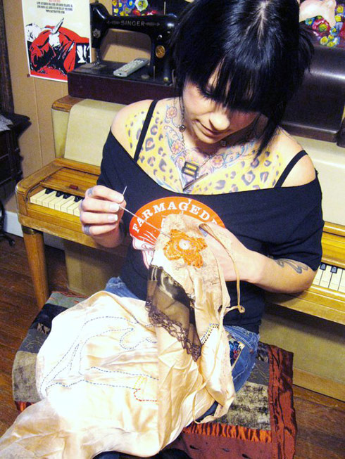 Danielle Colby Cushman does some hand stitching