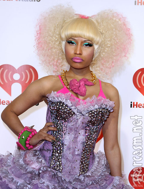 Nicki Minaj sports a split blond afro and a pink fried chicken wing necklace