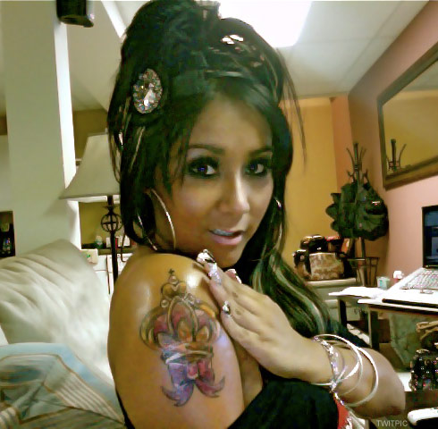 Snooki's large crown arm tattoo