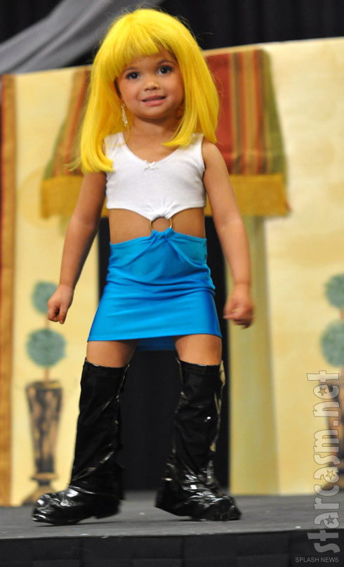 3 year old wearing a costume of Julia Roberts' prostitute cahracter Vivian Wade from Pretty Woman