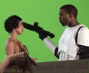 Kanye West in a stormtrooper costume points a gun at Princess Leia Kim Kardashian