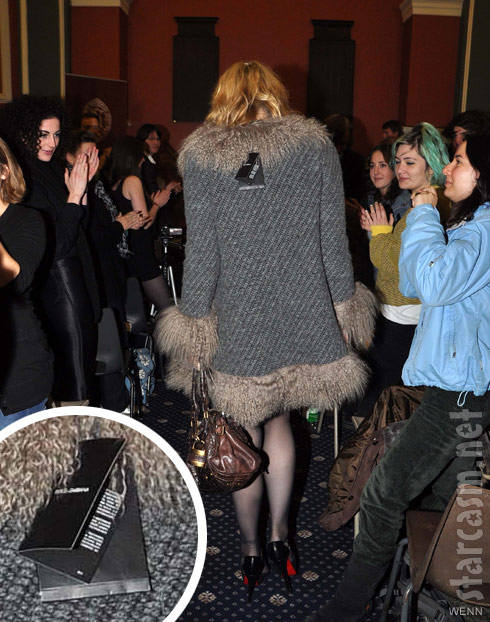 Courtney Love wears a coat with the tags still attached to Honorary Patronage ceremony