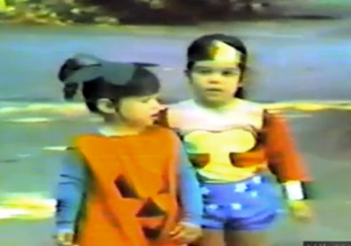 Kim Kardashian in a pumpkin costume and Kourtney Kardashian as Wonder Woman