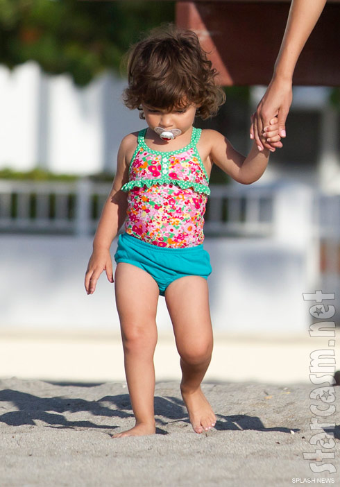 Teen Mom Farrah Abraham's daughter Sophia enjoys a stroll on the beach in Florida