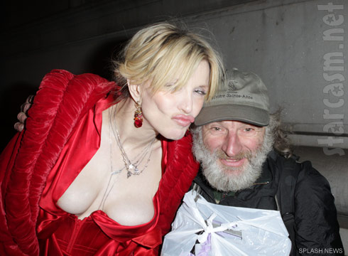 Courtney Love and her breasts pose with a homeless man in New York City