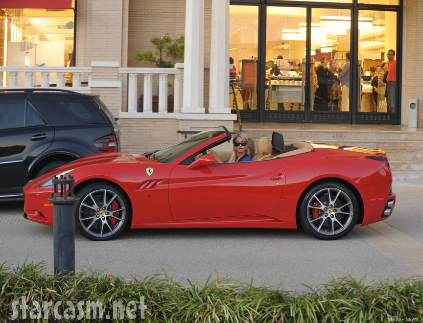 Paris Hilton driving her new red 2012 California Spyder Ferrari