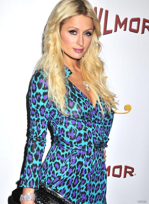 Paris Hilton wears a colorful leopard print dress