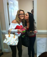 Jenelle Evans receives akiss from her new best pal and roommate Heather Inman