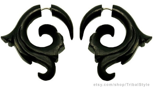 Ornate tribal horn earrings or fake gauges stretchers