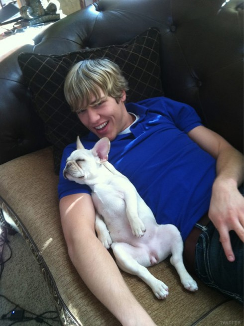 Caged star Daniel Payne poses with a dog
