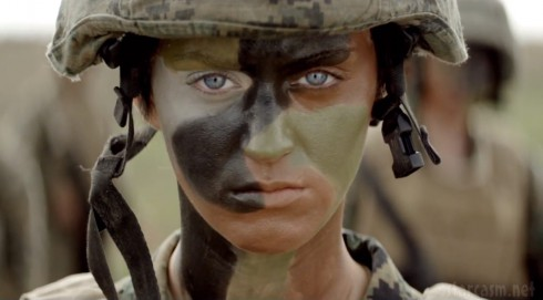 Katy Perry in camoflage face paint in the Part of Me music video