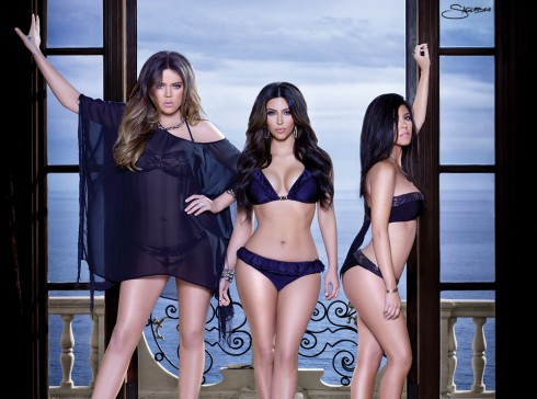 Kourtney Khloe and Kim Kardashian modeling bikinis from the Kardashian Kollection