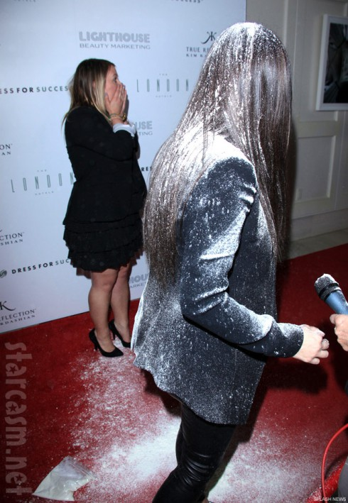 Kim Kardashian has a bag of flour dumped on her at a red carpet event
