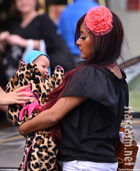 Snooki with a doll