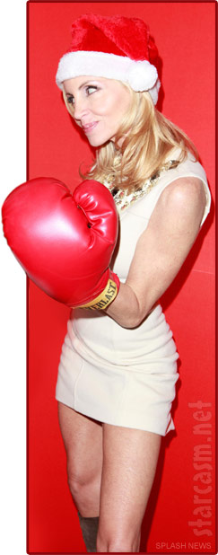 Camille Grammer wearing an over-sized boxing glove