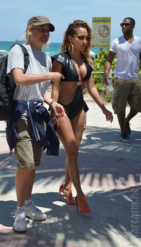 Empire Girls Adrienne Bailon in a bikini filming in Miami