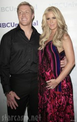 Kroy Biermann and Kim Zolciak together at red carpet event