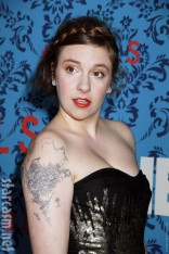 Lena Dunham lamb and flowers shoulder tattoo