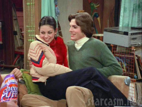 Mila Kunis and Ashton Kutcher as Jackie and Michael on That 70s Show