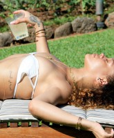 Rihanna strikes a sexy pose in a tiny white bikini in Hawaii 2012