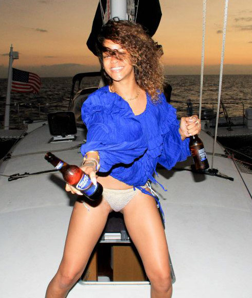 Rihanna partying in Hawaii wearing a bikini and drinking beer