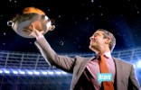 Andy Cohen holds up the flaming entre in the 2012 Summer by Bravo commercial