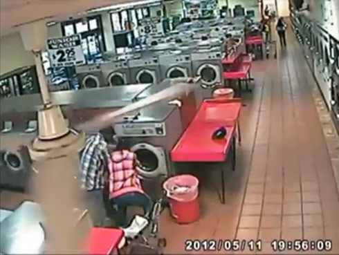 Laundromat security camera catches dad putting his child inside a washing machine