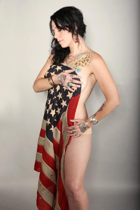 American Pickers Danielle Colby poses topless wrapped in an American