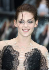 Kristen Stewart smiles at the Snow White and the Huntsman World Premiere in London