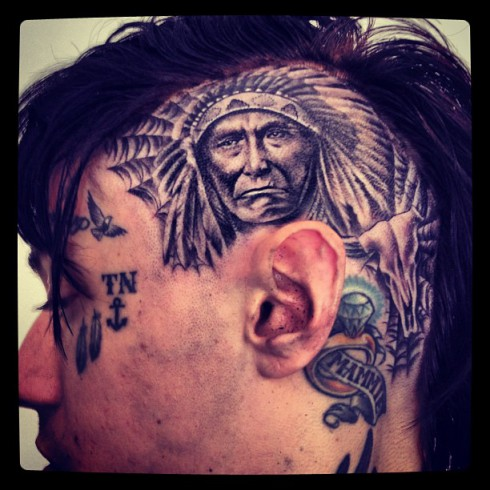 Trace Cyrus gets a Native American tattoo on his head