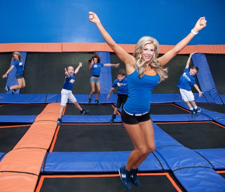 Alexis Bellino bouncing on a trampoline at Sky Zone trampoline park