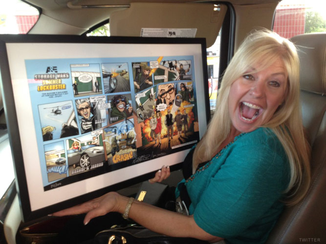 Laura Dotson shows off her limited edition signed print of the Storage Wars Lockbuster comic book spread