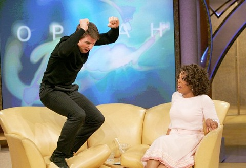 Tom Cruise jumping on Oprah's couch during talk show