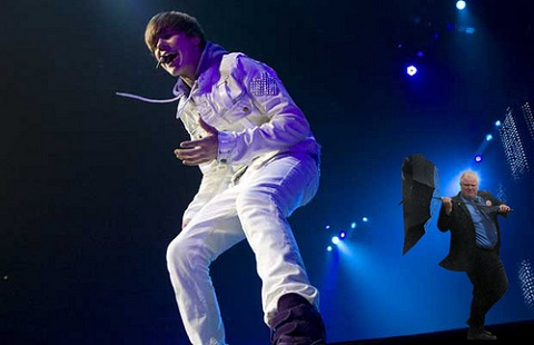 Justin Bieber singing at his concert
