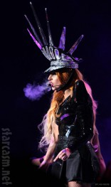 Lady Gaga as a biker with an elaborate spiked hat during Born This Way Ball concert
