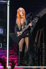 Lady Gaga plays guitar wearing sexy black costume during the Born This Way Ball